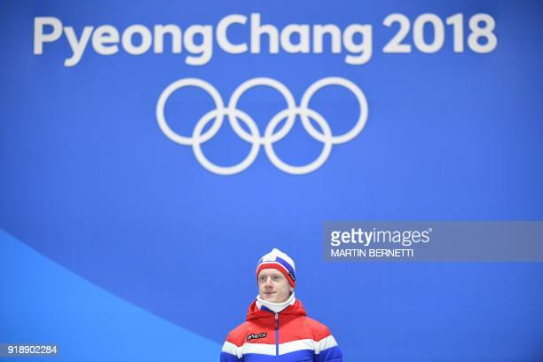 Norway's gold medallist Johannes Thingnes Boe poses on the podium during the medal ceremony for the men's biathlon individual 20km at the Pyeongchang...