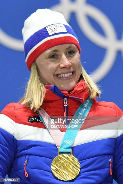 Norway's gold medallist Ragnhild Haga poses on the podium during the medal ceremony for the cross country women's 10km Free at the Pyeongchang Medals...