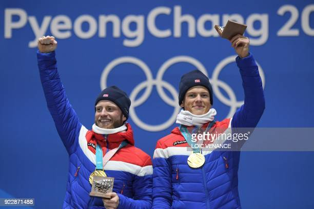 Norway's gold medallists Martin Johnsrud Sundby and Johannes Hoesflot Klaebo pose on the podium during the medal ceremony for the cross country men's...