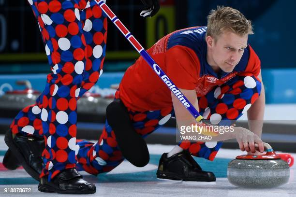 TOPSHOT Norway's Haavard Vad Petersson throws the stone during the curling men's round robin session between Norway and South Korea during the...