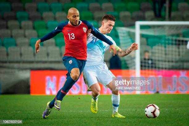 Norway's Haitam Aleesami vies for the ball with Benjamin Verbic of Slovenia during a UEFA Nations League football match Slovenia against Norway at...