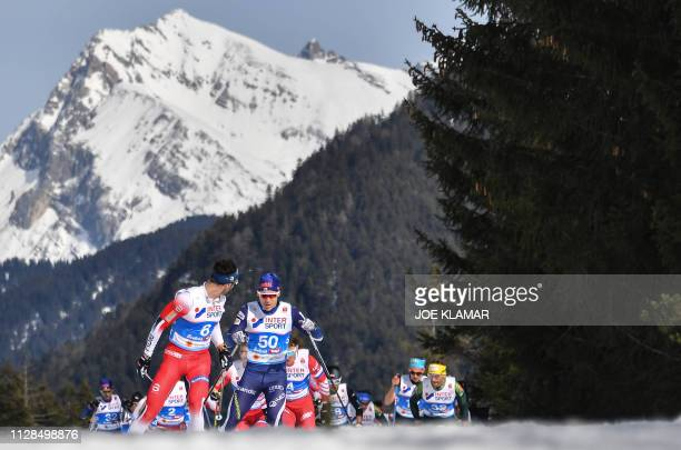 Norway's Hans Christer Holund leads a pack during the Cross-Country Men 50km Mass Start Free event at the FIS Nordic World Ski Championships on March...
