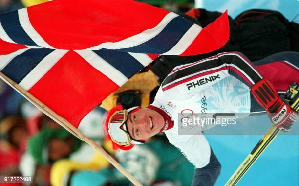 Norway's HansPetter Buraas holds up the Norwegian flag after the Men's Olympic Slalom 21 February at Mt Yakebitai in Shiga Kogen Buraas won the gold...