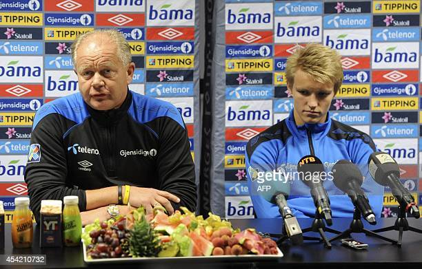 Norway's headcoach PerMathias Hoegmo and Norway's midfielder Martin Oedegaard attend a press conference in Stavanger Norway on August 26 2014 on the...
