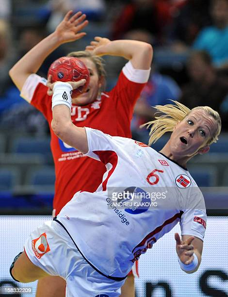 Norway's Heidi Loke vies with Denmark's Kristina Bille during their Women's EHF Euro 2012 Handball Championship match Norway vs Denmark on December...