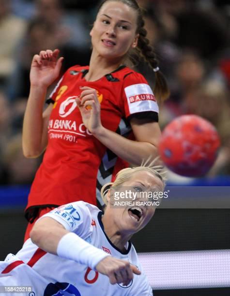 Norway's Heidi Loke vies with Montenegro's Radmila Miljanic during the Women's EHF Euro 2012 Handball Championship final match Norway vs Montenegro...