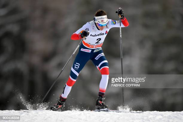 Norway's Heidi Weng competes in the Women's 10 km pursuit free during the cross country FIS World cup Tour de Ski event on January 1, 2018 in...