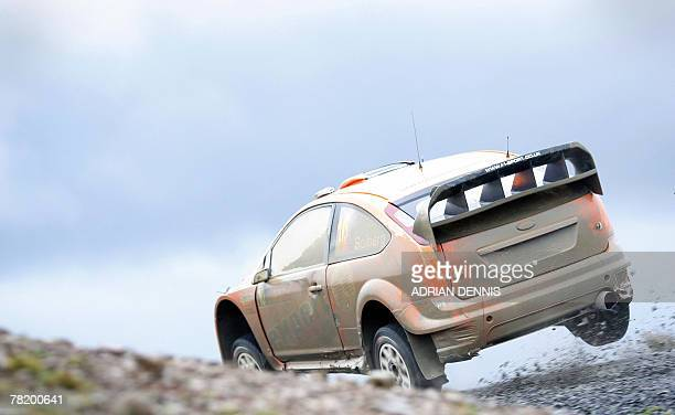 Norway's Henning Solberg drives a Ford Focus RS World Rally Car during Halfway 1 Stage 9 near Llandovery during the Wales Rally GB 01 December 2007...