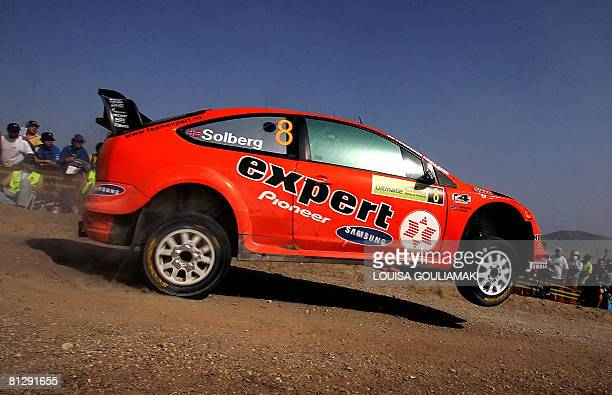 Norway's Henning Solberg with Cato Menkerud drive their Ford Focus during the 'Shimatari' special stage on the first day of the Acropolis rally in...