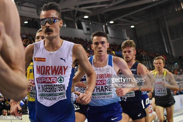 Norway's Henrik Borkja Ingebrigtsen and Great Britain's Chris O'Hare compete in the mens 3000m final event at the 2019 European Athletics Indoor...