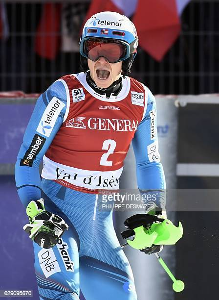 Norway's Henrik Kristoffersen celebrates after winning the FIS Alpine World Cup Men's Slalom in Val d'Isere in the French Alps on December 11 2016 /...