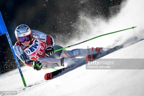 Norway's Henrik Kristoffersen clears a gate during the first run of the Men's giant slalom race at the FIS Alpine Skiing World Cup, on January 11,...