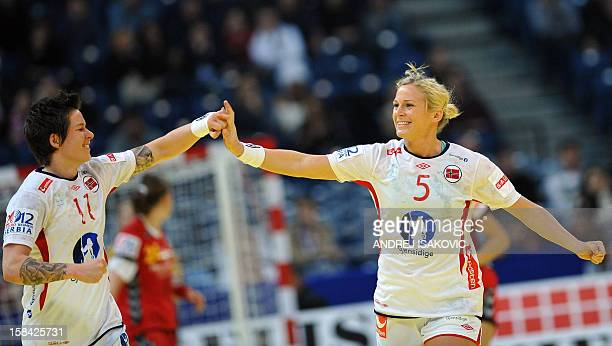 Norway's Ida Alstad and Anja Edin celebrate a goal during the Women's EHF Euro 2012 Handball Championship final match Norway vs Montenegro on...