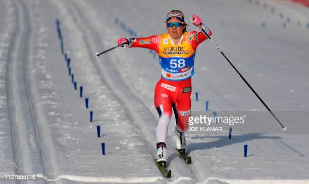 Norway's Ingvild Flugstad Oestberg crosses the finish line of the Ladies' 10km crosscountry event at the FIS Nordic World Ski Championships on...
