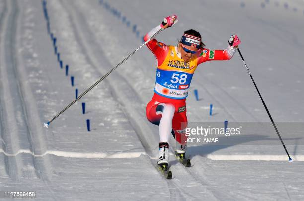 TOPSHOT Norway's Ingvild Flugstad Oestberg crosses the finish line of the Ladies' 10km crosscountry event at the FIS Nordic World Ski Championships...