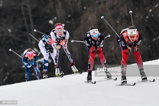 Norway's Ingvild Flugstad Oestberg, her compatriot Norway's Heidi Weng, Austria's Teresa Stadlober and Finland's Krista Parmakoski, compete on...