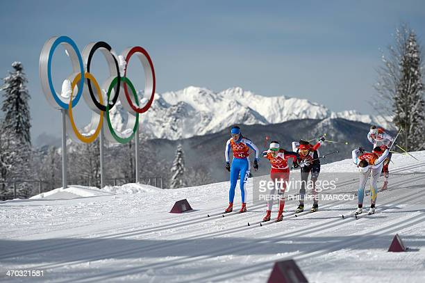 Norway's Ingvild Flugstad Oestberg leads the race during the Women's CrossCountry Skiing Team Sprint Classic Semifinals at the Laura CrossCountry Ski...