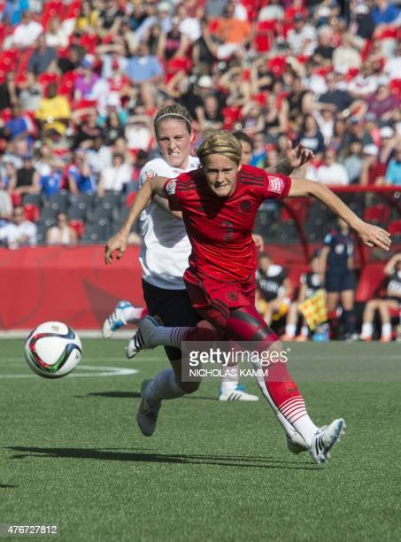 Norway's Isabell Herlovsen fights for the ball with Germany's Saskia Bartusiak during a Group B match at the 2015 FIFA Women's World Cup at Lansdowne...
