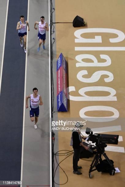 Norway's Jakob Ingebrigtsen competes to win ahead of Great Britain's Chris O'Hare and Norway's Henrik Borkja Ingebrigtsen in the mens 3000m final...