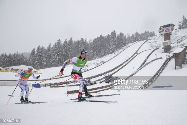 Norway's Jan Schmid and Austria's Wilhelm Denifl compete during the individual Gundersen of the FIS Nordic Combined World Cup on January 20 2018 in...