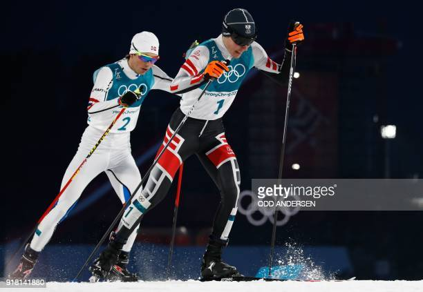 Norway's Jarl Magnus Riiber and Austria's FranzJosef Rehrl competes in the nordic combined men's individual normal hill NH/10km cross country at the...