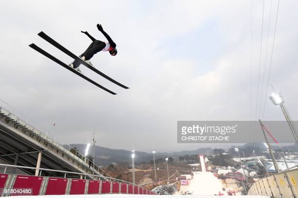 TOPSHOT Norway's Jarl Magnus Riiber competes in the nordic combined men's individual NH/10km jumping trial round at the Alpensia ski jump centre...