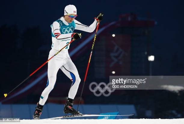 Norway's Jarl Magnus Riiber competes in the nordic combined men's individual normal hill NH/10km cross country at the Alpensia cross country centre...