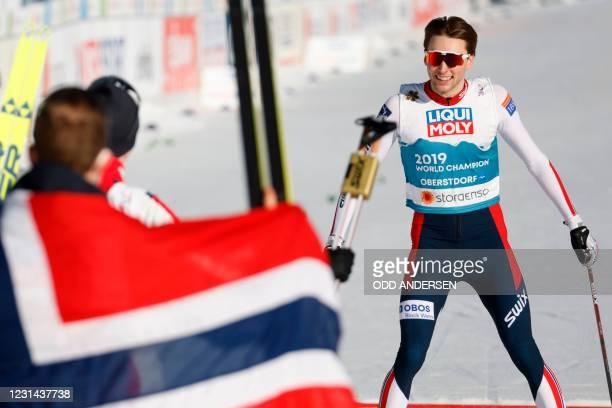Norway's Jarl Magnus Riiber crosses the finish line to win gold during the men's 4x5 km team competition event at the FIS Nordic Ski World...