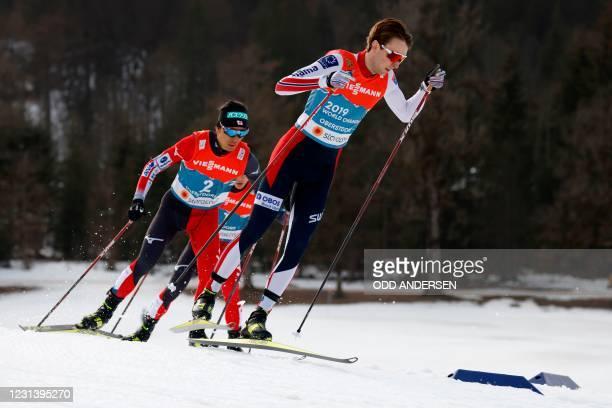 Norway's Jarl Magnus Riiber leads ahead of Japan's Akito Watabe after the first round as he competes in the men's 10km individual Gundersen Nordic...