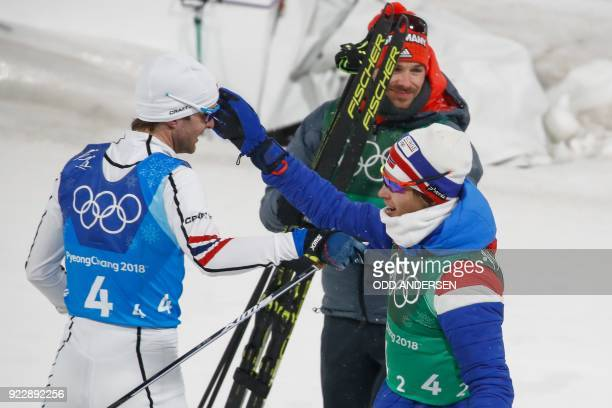 Norway's Joergen Graabak and Norway's Espen Andersen celebrate after placed second in the nordic combined team Gundersen LH/4x5km event at the...