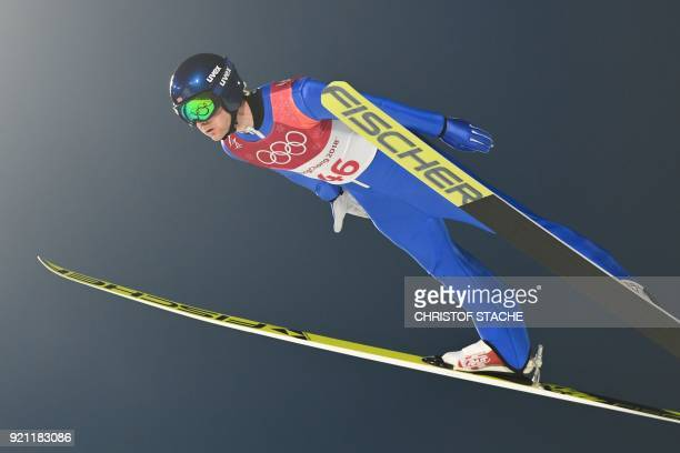 Norway's Joergen Graabak competes in the nordic combined individual Gundersen LH/10km ski jumping competition trial round at the Alpensia Ski Jumping...