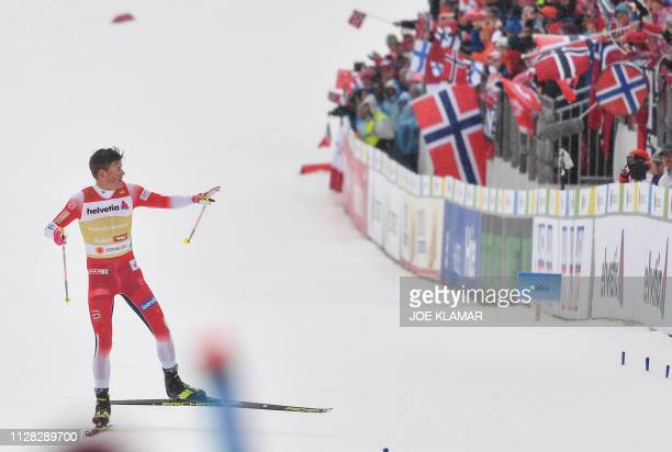 Norway's Johannes Hoesflot Klaebo approaches the finish line of the Men's cross country skiing relay 4x10km event at the FIS Nordic World Ski...