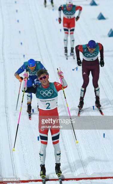 Norway's Johannes Hoesflot Klaebo crosses the finish line in front of Italy's Federico Pellegrino and Russia's Alexander Bolshunov at the men's...