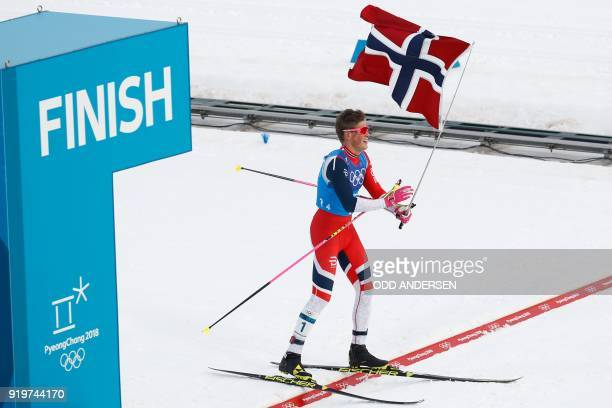 Norway's Johannes Hoesflot Klaebo crosses the finish line to win gold in the men's 4x10kms classic freestyle cross country relay at the Alpensia...