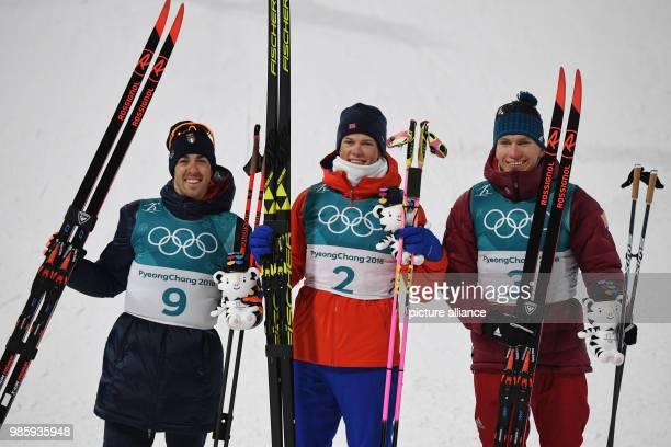 Norway's Johannes Hoesflot Klaebo Italy's Federico Pellegrino and Russia's Alexander Bolshunov celebrate their performances at the men's crosscountry...