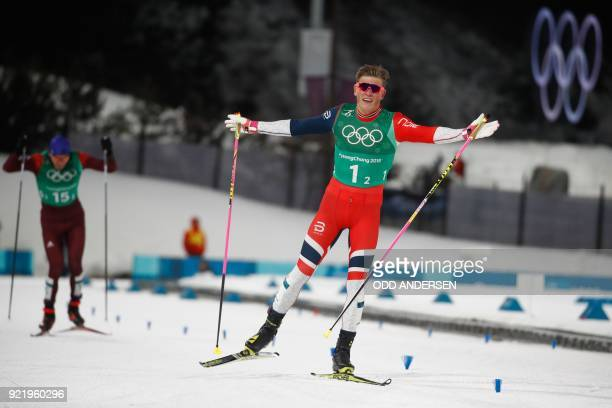 TOPSHOT Norway's Johannes Hoesflot Klaebo reacts as he crosses the finish line to win gold in the men's cross country team sprint free final at the...