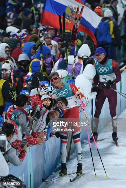Norway's Johannes Hoesflot Klaebo takes pictures after coming in first at the men's crosscountry skiing classic sprint at the Alpensia Centre in...