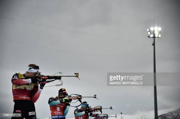 TOPSHOT Norway's Johannes Thingnes Boe and France's Quentin Fillon Maillet compete at the shooting range during the men's 15 km mass start event of...