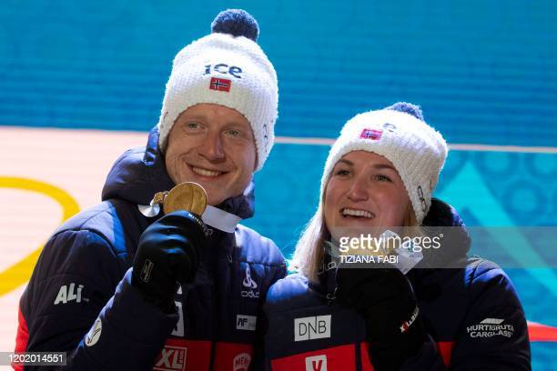 Norway's Johannes Thingnes Boe and Marte Olsbu Roeiseland pose on the podium with their medals after winning the IBU Biathlon World Cup Single Mixed...