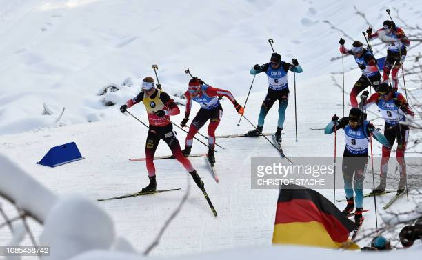 Norway's Johannes Thingnes Boe and other athletes compete in the men's 15 km mass start competion of the IBU Biathlon World Cup in Ruhpolding...