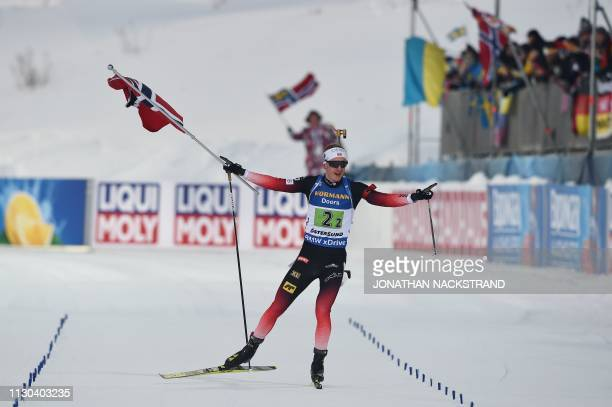 Norway's Johannes Thingnes Boe celebrates after winning the mixed relay event at the IBU Biathlon World Championships in Ostersund, Sweden, on March...