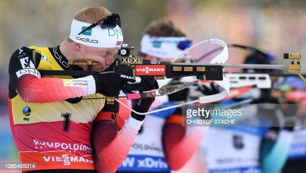 Norway's Johannes Thingnes Boe competes at the shooting range during the men's 15 km mass start competion of the IBU Biathlon World Cup in Ruhpolding...