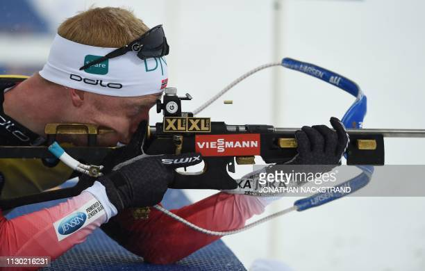 Norway's Johannes Thingnes Boe competes at the shooting range during the men's 20km individual event at the IBU Biathlon World Championships in...