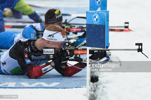 Norway's Johannes Thingnes Boe competes at the shooting range in the 4x7,5 km Mixed Relay event at the IBU Biathlon World Championships in Pokljuka,...