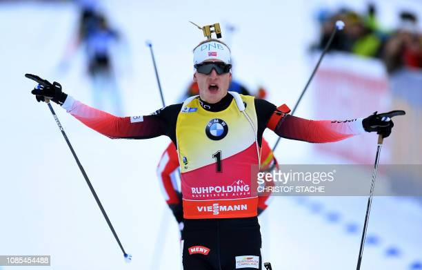 Norway's Johannes Thingnes Boe crosses the finish line to win the men's 15 km mass start competion of the IBU Biathlon World Cup in Ruhpolding...