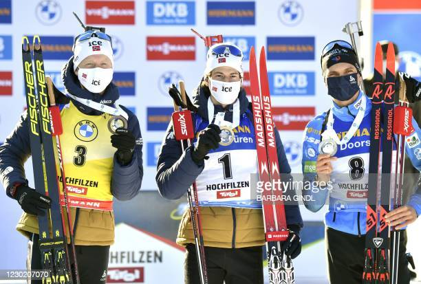 Norway's Johannes Thingnes Boe, Norway's Sturla Holm Laegreid and France's Emilien Jacquelin pose with their medals after the 12,5km pursuit...