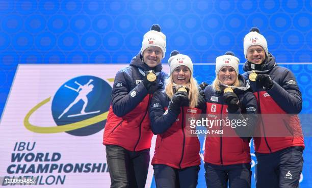 Norway's Johannes Thingnes Boe Norway's Tiril Eckhoff Norway's Marte Olsbu Roeiseland and Norway's Tarjei Boe pose with their medal on the podium...