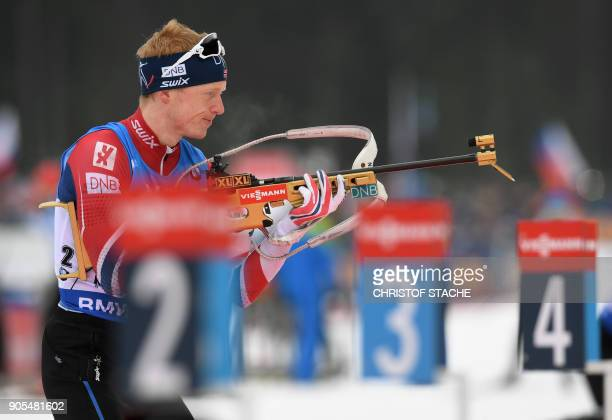 Norway's Johannes Thingnes Boe shoots during the warmup shooting prior the men's 15 kilometer mass start competition at the Biathlon World Cup on...