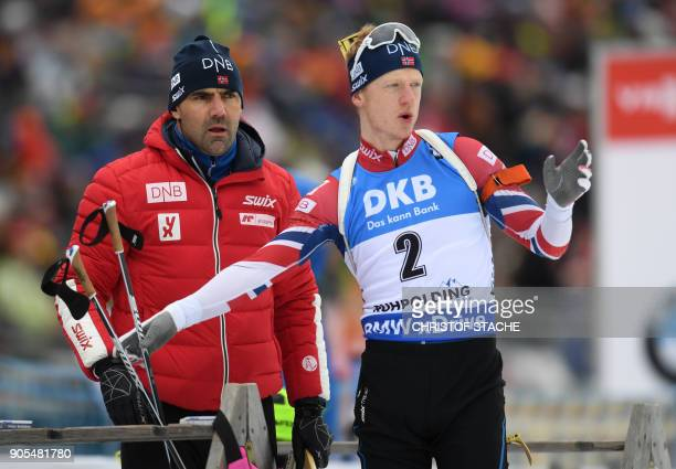 Norway's Johannes Thingnes Boe speaks with a team assistent during the warmup shooting prior the men's 15 kilometer mass start competition at the...