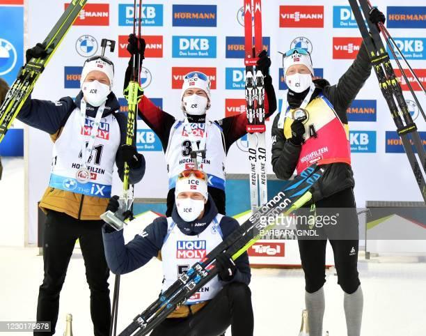 Norway's Johannes Thingnes Boe, Sturla Holm Laegreid, Johannes Dale and Vetle Sjastad Christiansen pose after the men's 10 km IBU Biathlon World Cup...